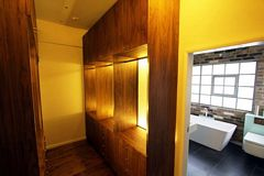 Walnut walk-in wardrobe